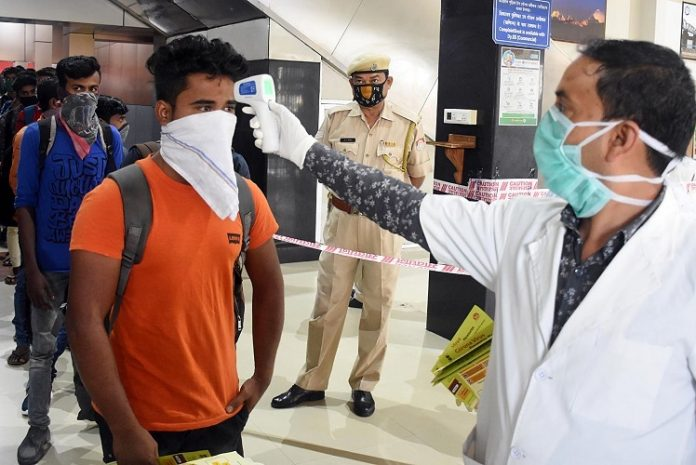 Thermal screening of passengers being conducted amid coronavirus outbreak, at Guwahati Railway Station in Guwahati on (ANI PHOTO)