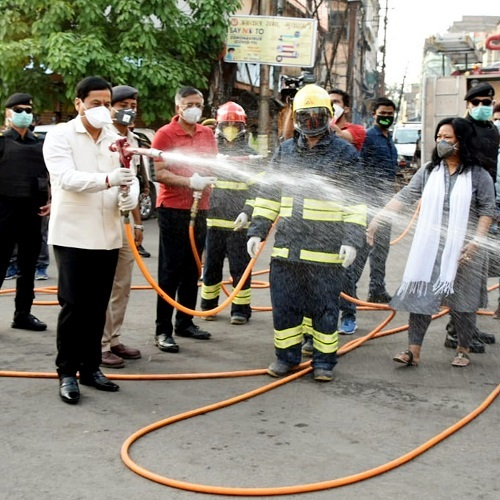 Assam Chief Minister Sarbananda Sonowal disinfectant the area as a precaution in the wake of Coronavirus pandemic, at Fancy Bazaar in Guwahati on Thursday. (ANI Photo)