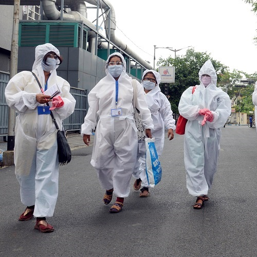 Health Department workers of Kolkata Municipal Corporation (KMC) wearing PPE conduct a survey during the nationwide lockdown to curb the spread of coronavirus, in Kolkata (ANI Photo)