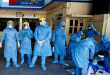 Doctors wearing protective suits before they start collecting swab from people, who are under home quarantine to test for COVID-19 in Ahmedabad on Wednesday. (ANI Photo)