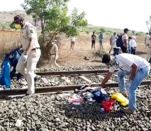 Police officials investigating at the railway track where 16 migrant workers died and several injured in a train accident in Aurangabad on Friday. (Photo: ANI)