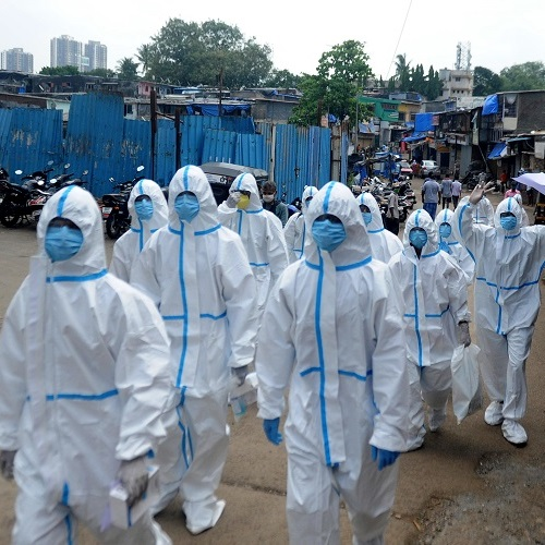 Health workers wearing protective suits arrive for a COVID-19 health check-up camp, at Appa Pada, Malad East in Mumbai on Thursday. (ANI Photo)
