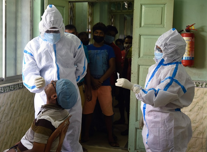 Health workers wearing PPE kits collect the nasal sample from a man for COVID-19 antigen rapid test, in Kolkata on Friday. (ANI Photo)