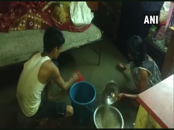 Rainwater entered the residential areas of Jabalpur on Sunday night, following heavy rainfall in the region (Photo/ANI)